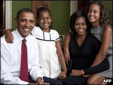 President Barack Obama (L), Michelle Obama (2nd R), daughters Malia (R) and Sasha in the White House on 1 September 2009