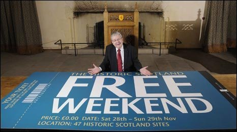 Mike Russell, Culture Minister, with a large Historic Scotland ticket, photo courtesy of Rob McDougall