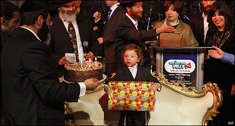 Moshe Holtzberg is seen here having his first hair cut in a traditional Jewish ceremony (18.11.09)