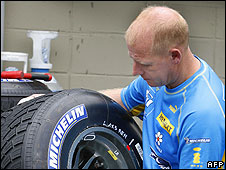 A Renault worker with tyre