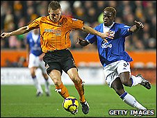 Hull's Andy Dawson (left) and Everton's Louis Saha each scored in the game between their two sides