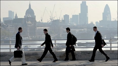 Commuters walking across across Waterloo Bridge