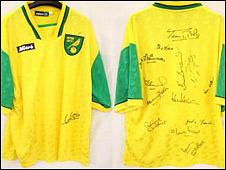 Replica Norwich City shirt signed by Johnny Gavin, Ron Ashman, Bernard Robinson, Ken Nethercott, Kevin Keelan, Terry Bly and seven others