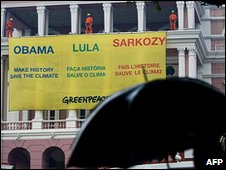 Greenpeace activists display a banner in Manaus, Brazil, 26 November 2009