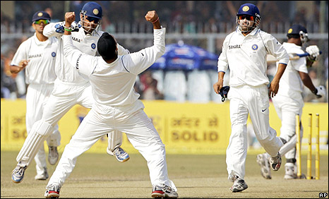 Harbhajan Singh celebrates taking the wicket of Prasanna Jayawardene
