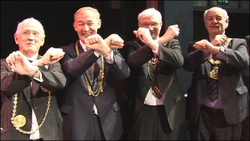 Mayors making X Factor sign