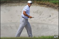Tiger Woods in a sandtrap