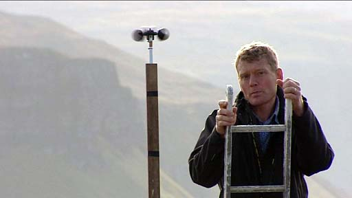 Tom Heap on ladder next to wind gauge
