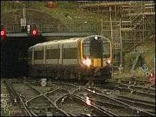 Passenger train emerges from the tunnel