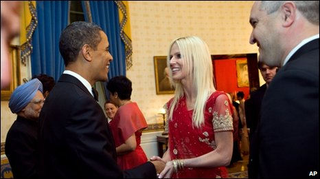 The White House photo shows Mrs Salahi shaking hands with Mr Obama