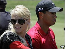 Elin Nordegren (left) and Tiger Woods