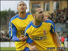 Staines Town's Howard Newton (left) and goalscorer Ali Chaaban (right)