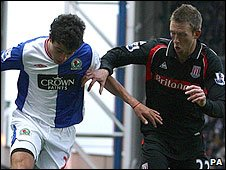 Blackburn's Franco di Santo and Stoke's Danny Collins tussle for possession