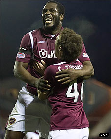 Christian Nade celebrates his headed goal for Hearts