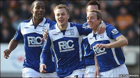 Birmingham midfielder Lee Bowyer, right, celebrates his opener