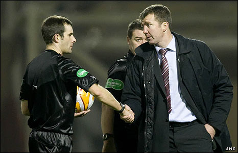 Jim Gannon shakes hands with referee Alan Muir