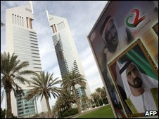 A billboard picture of Dubai's ruler Sheikh Mohammed bin Rashed al-Maktoum outside the Emirates Twin Towers