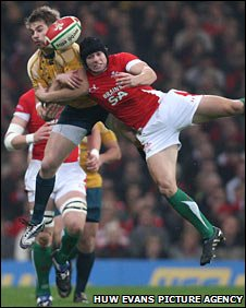 Australia's Drew Mitchell challenges Leigh Halfpenny for a high ball