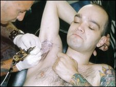 Graham having his armpit tattooed