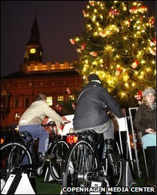 Cyclists lighting the Christmas tree in Copenhagen