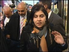 Baroness Warsi being pelted with an egg