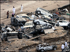 Saudi men inspect flood damage