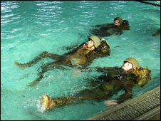Recruits learning to swim with full kit on