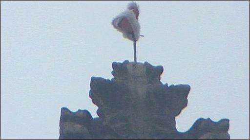 Hat on chapel spire