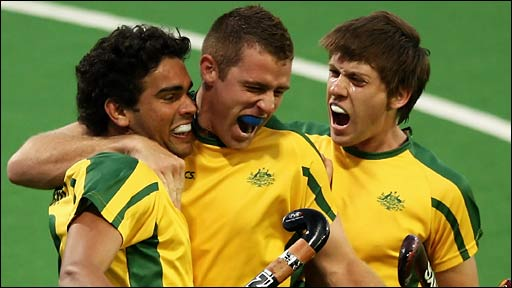 Australia hockey players celebrate beating England
