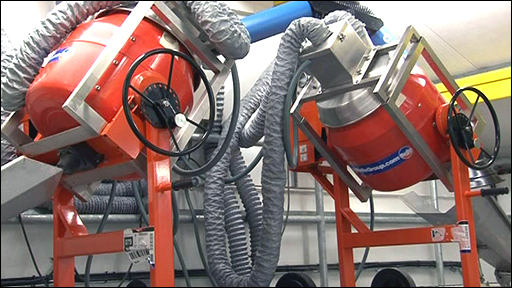 Machine dries and sifts through explosive debris