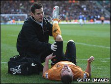 Michael Kightly receives treatment during the game