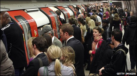 Crowds queue to get on an Underground train