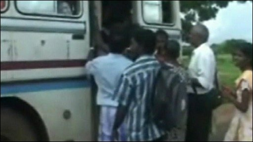 Sri Lankans boarding bus