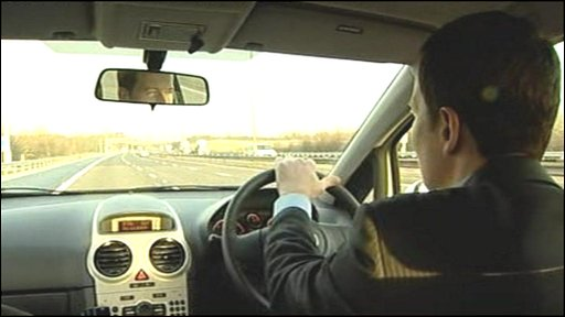 Reporter Giles Latcham on motorway