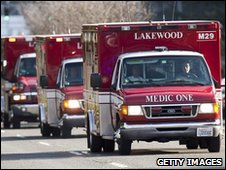 Ambulances with the bodies of the four slain police officers travel to a funeral home in Lakewood, Washington state, on 1 December 2009