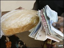 A Zimbabwean buys a loaf of bread