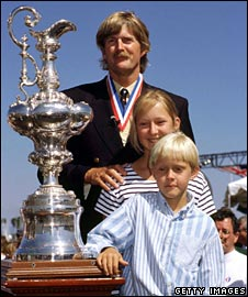 Sir Peter Blake with his children, posing with the America's Cup