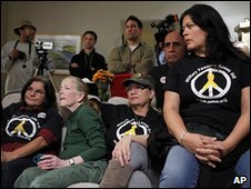Military families and veterans gathered to watch President Barack Obama's speech on sending troops to Afghanistan in Long Beach, California, 1 December 2009