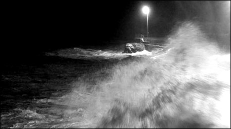 The stormy seas lashed the harbour