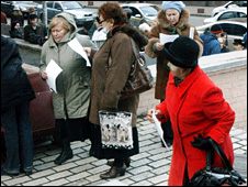 People queue outside a bank in Kiev