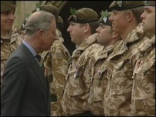 The Prince of Wales talks to soldiers