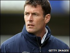 Lincoln City manager Chris Sutton