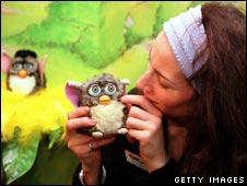 Woman handles a Furby