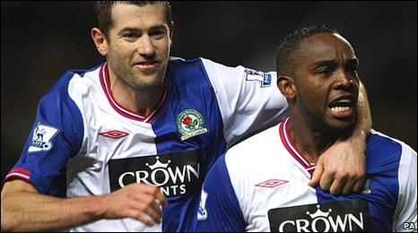 Benni McCarthy (right) celebrates scoring the winner with Brett Emerton