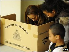 A woman casts her vote in the Honduran persidential election on 29 November