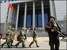 Chinese security outside court in Urumqi, Xinjiang. File photo - 12 September 2009