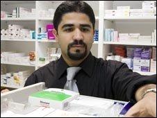 Pharmacist choosing a drug