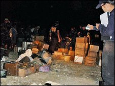 Boxes of weapons and ammunition found buried outside Ampatuan family home in the southern Philippines - 3 December 2009