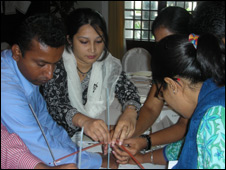 Participants in the workshop take part in a team building exercise