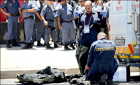 A bomb disposal unit investigates a threat at the World Cup draw venue